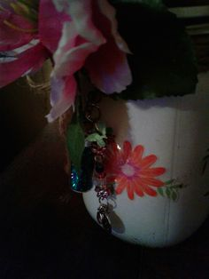Butterfly candle holder vase has charms of flowers and butterflys comes with little bottle of fairy dust