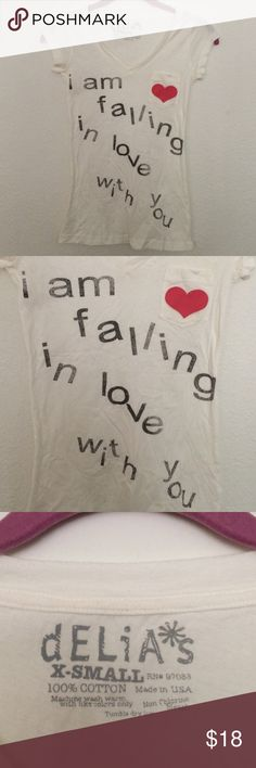 New XS Heart Pocket Falling In Love With You Tee Super cute. Never worn. Not nasty gal- see tag photo. Made in USA. Nasty Gal Tops Tees - Short Sleeve