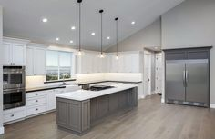 Gray And White Kitchen With Large Island Pendant Lights Vaulted Ceiling