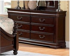 With tasteful French-style detailing, this classic Westchester dresser will bring an elegant touch to any bedroom! Constructed using solid, sturdy pine and finished in a lovely brown/cherry colour, this piece of furniture will last for years to come! Corner-blocked construction ensures a robust, long-lasting dresser.