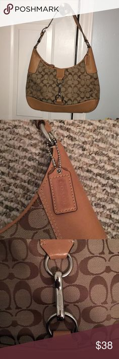 Authentic coach purse Used maybe once for a dinner party. Handbag type purse. Authentic symbols and emblems in the bag. Originally 150$ Coach Bags Shoulder Bags