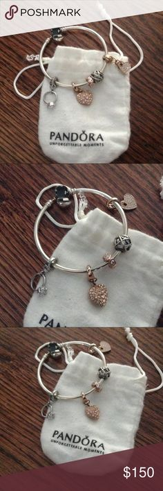 Pandora bangle Beautiful Pandora bangle with two pandora charms and three  Fossil charms. pandoa/ fossil  Accessories