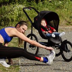 phil&teds sub 4 jogging stroller with athlete stretching