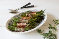 Don't keep this appetizer under wraps! These easy-yet-elegant bacon-wrapped green bean bundles are sure to steal the spotlight at your next party. Green Bean Bundles, Bacon Wrapped Green Beans, Austrian Cuisine, Keto Recipes, Cooking Recipes, Elegant Appetizers, Southern Recipes, Healthy Eating, Stuffed Peppers