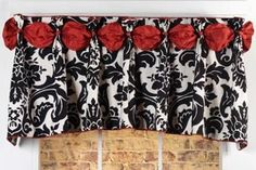 valance for kitchen. Not thrilled about the fabric but love the idea.