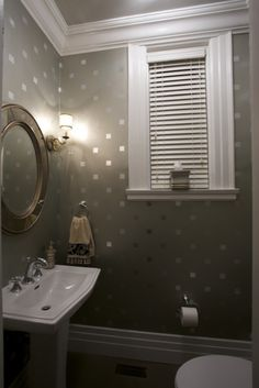 Finally! A nice visual for my plans for the bathroom. Metallic paint stencilled over a gray base coat.