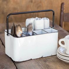 Let this charming vintage white cutlery caddy bring the farmhouse to your table! Perfect for the dining room or the outdoor table, this 11 in. high cutlery caddy is a vintage piece of country utility!