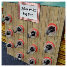 """Captain Hook's ring toss for pirate party. """"Wood"""" scrapbook paper on 2 thick insulation boards. Sturdy, incredibly lightweight, and LOTS of fun!"""
