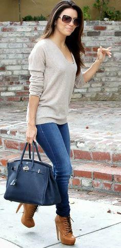 Sweater and neutral tone booties on Eva Longoria