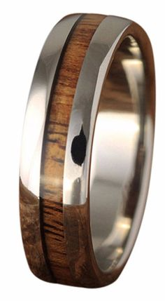 Handcrafted titanium ring with a genuine koa wood inlay. This is one awesome mens or womens wood ring or even a his and her ring set.