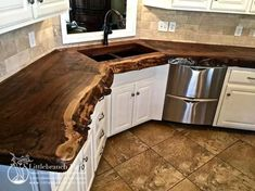 Natural wood countertops - live edge wood slabs Nothing matches the warmth and beauty of natural wood countertops. Whether it is a wide plank wood countertop or is accented with a natural live edge wood Kitchen Decor, Wood Countertops Kitchen, Outdoor Kitchen Design, Rustic Kitchen Cabinets, Diy Wood Countertops, Kitchen Design, Diy Kitchen, Kitchen Renovation, Rustic Kitchen