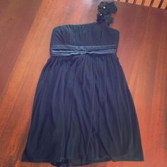 Macy's Dress Worn once for a homecoming dance. Formal dress- one strap with flowers on the strap and a jewel in the center of each. Size medium fits true to size, the material is chiffon with a sash bow tie on the back. Macy's Dresses
