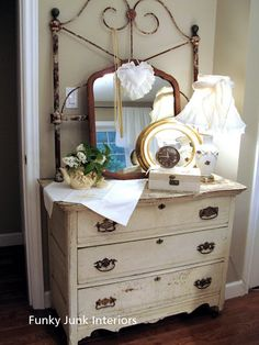 old iron headboard and vintage dressers! Funky Junk Interiors