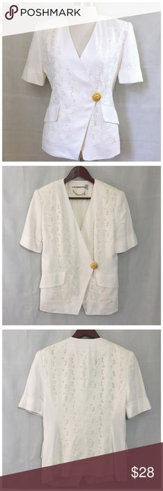 "Vintage Liz Claiborne White Floral Eyelet Blazer 8 Vintage Liz Claiborne White Floral Eyelet Short Sleeve Blazer • Sz 8 • Short sleeve Blazer • Rayon shell • Fully lined • White Floral Eyelet embroidered panels • Two functional pocket • Cuff sleeves • Wrap closure with interior button and gold exterior flower button • Shoulder pads • 18.5"" bust (flat) • 15.5"" shoulders • 3.5"" sleeve inseam • 16.25"" waist • 25"" length (front) • 23"" length (back) • Asymmetrical hem • Wrap style • Excellent…"