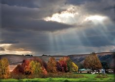 Sun rays peek through Autumn clouds on the Midlands Meander, KZN, South Africa. www.midlandsmeander.co.za