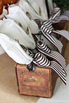 Snappy brown and white striped ribbon add graphic appeal to a Thanksgiving buffet table. 20 Chic Thanksgiving Crafts to Decorate Your Table Thanksgiving Table Settings, Thanksgiving Tablescapes, Holiday Tables, Thanksgiving Crafts, Thanksgiving Decorations, Christmas Tables, Outdoor Thanksgiving, Styling A Buffet, Fall Table
