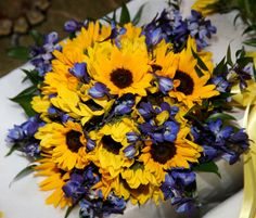 Sunflower and delphinium bouquet. (flowers by Lee Forrest Design, photo by: Jen Adams Photography)