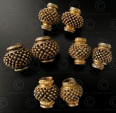 Tamil eight 18K gold beads with lattice and granulations.Tamil Nadu, Southern India.19th-early 20th century. Total weight: 12.8 gr.
