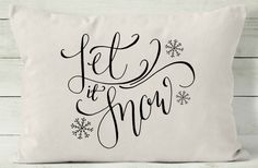 "Decorative throw pillow covers are a quick and easy way to decorate your home for holidays. Change your pillow cover and you have a whole new look! This 12 x 16 quote pillow reads ""let it snow"" accented by hand drawn snowflakes. Handmade with natural cotton, it is perfectly neutral to complement any decor. DETAILS • 12"" x 16"" pillow cover. • Printed in black with permanent, water resistant ink. • Envelope style back closure. • Pillow insert is not included.  FABRIC OPTIONS • White: 100%…"
