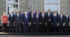 Photos taken at an EU summit in Estonia show Theresa May distanced from other leaders, a reflection of the UK's distant relationship with the European Union. The prime minister stands at the back of a group of key EU figures in one photo - with Angela Merkel at the opposite end. In another image, the German Chancellor makes a binoculars gesture whilst Ms May sits alone waiting for the start of a working session at the digital summit in Tallinn.
