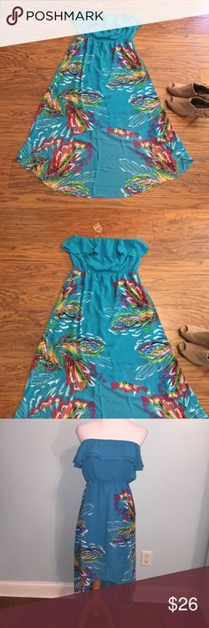 NWT! Hi-lo strapless dress by Umgee Large. Bright blue with abstract tropical print. Hi-lo hem line, maxi length in back. Ruffle at neckline. Lined to knee length. Elastic at waistline and elastic gripper band on top. Cotton/polyester blend. Umgee Dresses Strapless