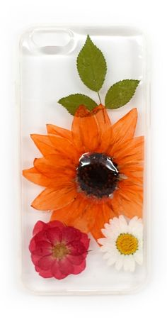 To say that we are obsessed with these gorgeous phone cases would be an understatement! We love the unexpected combo of real, dried flowers mixed with modern technology. The clear case allows the beauty of the flowers to really stand out against your phone. For the iPhone 6.