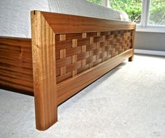 Wenge and Sapele raised platform bed and wall mounted bedside tables with…