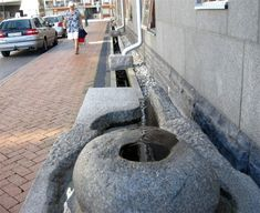 This sidewalk in Malmo, Sweden uses stormwater captured on the neighboring rooftop in an artful way that enhances the pedestrian experience during a rain event.