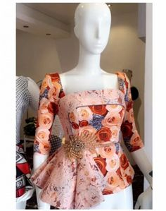 Why limit your Ankara style to mid or long dresses and simple tops when you can wear the iconic peplum staples! Just in time for the holidays, you can choose… Latest African Fashion Dresses, African Print Dresses, African Print Fashion, Africa Fashion, African Dress, African Blouses, African Tops, African Women, African Attire