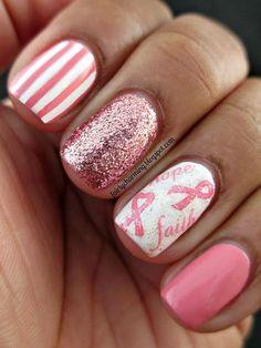 Adorable nail design with striped nail, sparkle nail, and a pink ribbon nail!