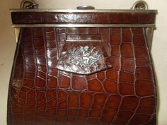 Stunning rare Art deco French crocodile handbag with silver cherub pull tab by VintageHandbagDreams on Etsy