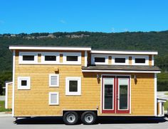 A steel frame lofted tiny house on wheels in Chattanooga, Tennessee. Designed and built by Tiny House Chattanooga. | Tiny Homes
