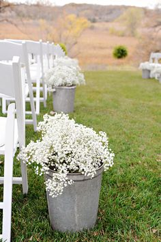 Love this budget-friendly wedding flower idea - pots of gypsophila make a big impact for little cost
