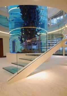 Staircase that wraps around a fish tank. Awesome.