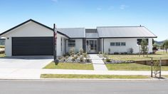 Street view with double parking for this modern G.J. Gardner Home.