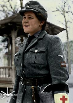Norwegian Volunteer Front Nurse Grete Knudsen. She served with an SS-Gebirgsjäger unit in Finland, as denoted by her cap Edelweiß. Next to her 'frontsösters' bag hangs a Finnish Puukko knife.  Her brother Hans-Christian was an SS-Untersturmführer and was killed Feb. 25, 1943 by sniper fire near Gongozi, Russia. She wears a black armband in mourning. (Colourised by Reparations, Tumblr. Click for source).