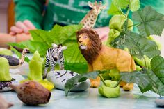 add some small toys to your playdough center to bring a new scene to life!
