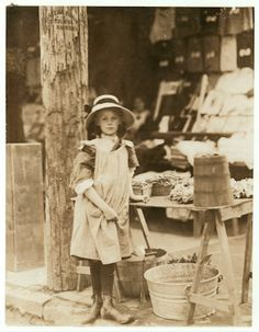 "STREET LIFE: In the shadow of City Hall, selling vegetables at 515 King St., Wilmington, Delaware. Investigator, Edward F. Brown. Location: Wilmington, Delaware"". 1910. Child Labor"