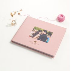 This special hand crafted leather album in a never seen before palette of baby pink and maroon red is bound to make your heart skip a heart beat