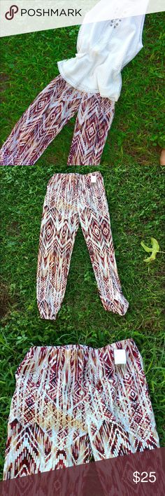 """IKAT Holiday Pant Brand new boutique item, winter white and wine red ikat print is the perfect holiday Pant. Size small inseam:26"""" waist looks super cute with summer law or winter white sweaters and ankle boots! Anthropologie Pants Trousers"""
