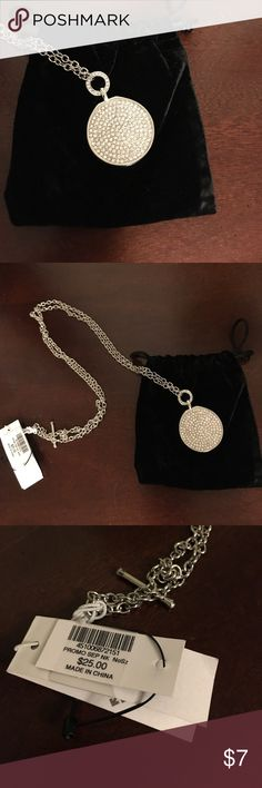 Chico's Pendant  Necklace with Toggle Closure Large diamond-like stone pendant on a toggle necklace that is convertible to be work short at the throat or long down middle of chest - 18 inches in length when worn long.  Pendant is 1.5 inches in diameter. Chico's Jewelry Necklaces