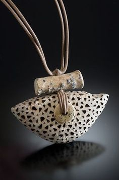 Pendant | Nina Morrow. Driftwood, shaped, with burnt design,bone bead and strung on cotton cord
