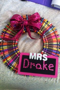 Here's a cute DIY project for your kids to make for their teacher this Christmas.  Use crayons, ribbon, glue, and a sign with their name to make a wreath to hang in their classroom.