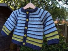 A simple and fuss free baby cardigan, ideal for a knitter who is new to seamless knitting, this tiny garment allows for lots of customisation to suit baby girls and boys alike. Baby Knitting Free, Baby Cardigan Knitting Pattern Free, Baby Boy Knitting Patterns, Cardigan Pattern, Knitting For Kids, Baby Knitting Patterns, Crochet For Kids, Baby Patterns, Knit Baby Sweaters