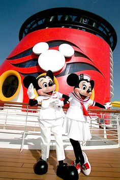 Disney Cruise Lines. Mickey and Minnie Mouse greet guests arrive on the Disney Magic cruise ship in 1998.