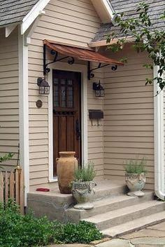 Love The Awning Door Style Combo I Would Love This Over The Side Door Garageremodelingdiy Metal Awning Front Door Awning House Exterior