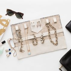 """This leather travel jewelry roll is perfect for keeping your jewelry organized while you're globetrotting. The kit comes with a step by step guide, and you can check out the full DIY tutorial <a href=""""http://www.brit.co/diy-leather-jewelry-roll/ """">HERE</a>.  Fill up your Jewelry Roll with C+I jewelry. Sign-up today and enjoy 20% off your next <a href=""""http://www.chloeandisabel.com/britcofeb2016"""">Chloe + Isabel</a> jewelry purchase!  <strong>Kit Includes:</strong> – 16 x 22 inch piece of…"""