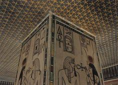 On the ceiling is a pattern of gold stars on a dark blue background. Tomb KV35 - pillar showing images of pharaoh Amenhotep II. With Scarab on left