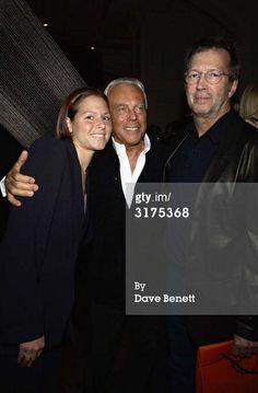 LONDON - OCTOBER 14: Italian designer Giorgio Armani, American musician Eric Clapton and wife Melia.
