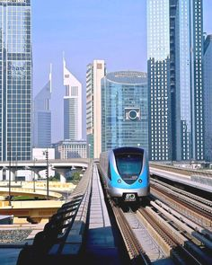 Dubai architecture – buildings of the United Arab Emirates Illustration Description Dubai metro A city with modern architecture, one of the world's most amazing buildings and luxury – for 40 years of poor fishing spot Dubai has grown into a. Dubai City, Dubai Uae, Places To Travel, Travel Destinations, Places To Visit, Futuristic Architecture, Amazing Architecture, Living In Dubai, Amazing Buildings